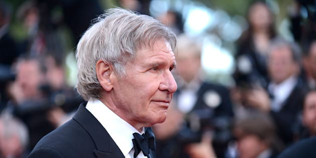 Harrison Ford arrives for the screening of The Homesman at the 67th international film festival, Cannes, southern France, Sunday, May 18, 2014. (Photo by Arthur Mola/Invision/AP)