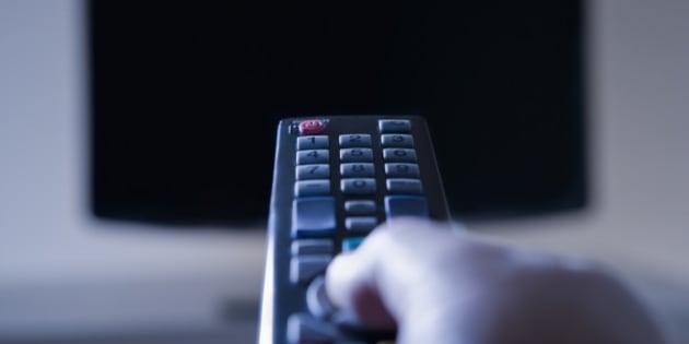 Hispanic man using remote control
