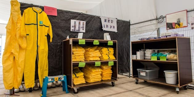 This picture shows a general view of a mock-up testing centre at a simulation facility for Ebola field training, organized by the Non-Governmental Organisation (NGO) Medecins Sans Frontieres (MSF-Doctors Without Borders) in Brussels on March 12, 2015.  AFP PHOTO / BELGA / JONAS ROOSENS - Belgium Out        (Photo credit should read JONAS ROOSENS/AFP/Getty Images)