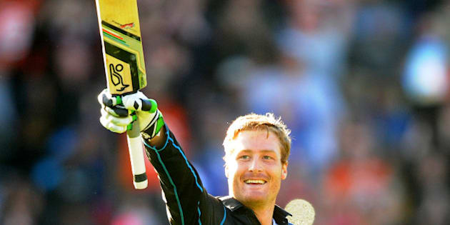New Zealand's Martin Guptill celebrates after scoring a double century while batting against the West Indies during their Cricket World Cup quarterfinal match in Wellington, New Zealand, Saturday, March 21, 2015. (AP Photo/Ross Setford)