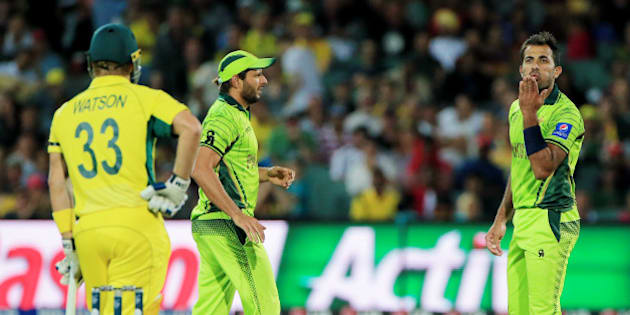 Pakistan's Wahab Riaz blows a kiss to Australia's Shane Watson, left, during their Cricket World Cup quarterfinal match in Adelaide, Australia, Friday, March 20, 2015. (AP Photo/James Elsby)
