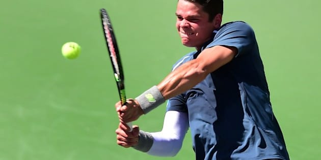 Milos Raonic of Canada hits a backhand return to  Roger Federer of Switzerland during their semifinal match at the BNP Paribas Tennis Open in Indian Wells, California on March 21, 2015. Federer defeated Raonic 7-5, 6-4. AFP PHOTO/ FREDERIC J. BROWN        (Photo credit should read FREDERIC J. BROWN/AFP/Getty Images)