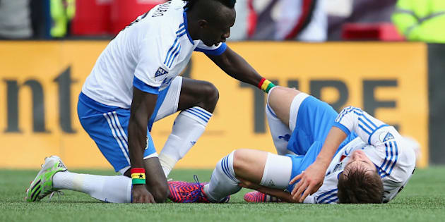 FOXBORO, MA - MARCH 21:  Hassoun Camara #6 of Montreal Impact comforts Eric Alexander #29 after he was injured during the first half against the New England Revolutionat Gillette Stadium on March 21, 2015 in Foxboro, Massachusetts.  (Photo by Maddie Meyer/Getty Images)