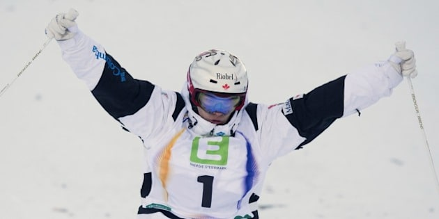 Canada's Mikael Kingsbury celebrates during the Men's Moguls final of FIS Freestyle and Snowboarding World Ski Championships 2015 in Kreischberg, Austria on January 18, 2015. France's Anthony Benna won gold medal ahead of the silver Canada's Mikael Kingsbury and bronze took Russia's Alexandr Smyshlyaev.  AFP PHOTO / JOE KLAMAR        (Photo credit should read JOE KLAMAR/AFP/Getty Images)