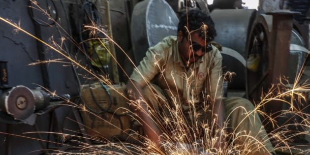 Sparks fly as an employee uses an angle grinder at an Ishwar Engineering Co. factory in Mumbai, Maharashtra, India, on Saturday, Feb. 7, 2015. The International Monetary Fund is predicting India will next year grow faster than each of its BRIC counterparts for the first time since 1999. Photographer: Dhiraj Singh/Bloomberg via Getty Images