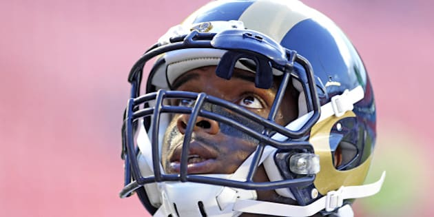 MIAMI GARDENS, FL - AUGUST 28:  Defensive end Michael Sam #96 of the St. Louis Rams looks up during pregame workouts before his team met the Miami Dolphins at Sun Life Stadium on August 28, 2014 in Miami Gardens, Florida.  (Photo by Marc Serota/Getty Images)