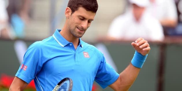 Novak Djokovic of Serbia reacts after winning a point against  Roger Federer of Switzerland in the men's final of the BNP Paribas Tennis Open in Indian Wells, California on March 22, 2015. AFP PHOTO / FREDERIC J. BROWN        (Photo credit should read FREDERIC J. BROWN/AFP/Getty Images)