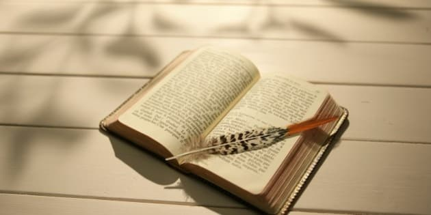 Open book and a quill pen