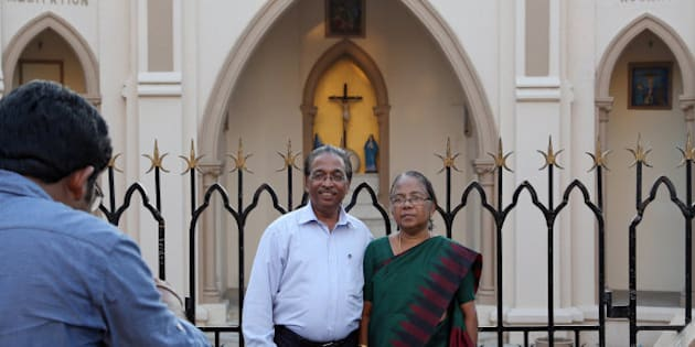 "A christian couple poses for a photograph outside a church in Mumbai, India, Tuesday, March 17, 2015. India's Prime Minister Narendra Modi said Tuesday that he was ""deeply concerned"" about the recent rape of a nun and the destruction of a church, but Christian groups said his words did little to dispel the fear gripping the tiny community since his rightwing Hindu government came to power. (AP Photo/Rajanish Kakade)"