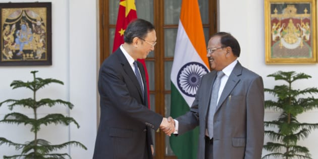 India's National Security Adviser Ajit Kumar Doval, right, and Chinese State Councilor Yang Jiechi shake hands before the start of the 18th round of talks on India-China border dispute in New Delhi, India, Monday, March 23, 2015. Yang is on a two-day visit to the country. (AP Photo/Manish Swarup)