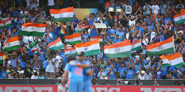 MELBOURNE, AUSTRALIA - MARCH 19:  Fans celebrate as Suresh Raina of India celebrates making 50 runs during the 2015 ICC Cricket World Cup Quater Final match between India and Bangldesh at Melbourne Cricket Ground on March 19, 2015 in Melbourne, Australia.  (Photo by Quinn Rooney/Getty Images)