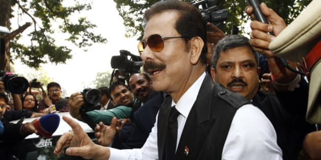 NEW DELHI, INDIA - MARCH 4: Sahara Chairman Subrata Roy arrives at the Supreme Court on March 4, 2014 in New Delhi, India. An attacker, Manoj Sharma, claiming to be a lawyer from Gwalior, Madhya Pradesh managed to get close to Roy in the crowd and threw black ink on him. He was later detained and led away. Subrata Roy, head of the Sahara India conglomerate was accused by India's regulatory body SEBI of raising nearly 200 billion rupees ($3.2 billion) through bonds that were later found to be illegal.  (Photo by Arun Sharma/Hindustan Times via Getty Images)