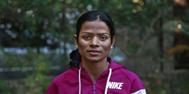 In this Wednesday, Oct. 29, 2014 photo, Indian athlete Dutee Chand poses for the camera in Mumbai, India. The 18-year-old has now decided to fight the ban for 'hyperandrogenism' or the presence of high levels of testosterone in the body that makes the sprinter ineligible to compete according to International Association of Athletics Federation rules. Chand won two gold medals at the Asian junior track and field championship. (AP Photo/Rafiq Maqbool)