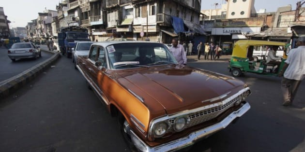 An Indian man drives his vintage Chevrolet during a vintage car rally in Ahmadabad, India, Sunday, Nov. 24, 2013. The rally was held as part of the World Heritage Week celebrations. (AP Photo/Ajit Solanki)