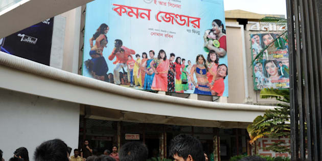 Bangladeshi men look at a billboard advertising the film 'Common Gender' at a movie theatre in Dhaka on July 6, 2012.   A film about a love affair between a transgender person and a Hindu boy has become a surprise hit in Bangladesh, with distributors saying on July 8 that it would now be given a general release. 'Common Gender', Bangladesh's first film dealing with transgender people often known as hijras, opened in just six cinemas two weeks ago but full houses have encouraged cinema owners to extend its run and screen it nationwide.   AFP PHOTO/Munir uz ZAMAN        (Photo credit should read MUNIR UZ ZAMAN/AFP/GettyImages)