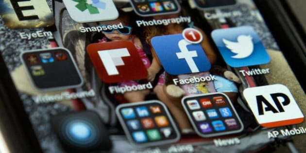FILE - This May 21, 2013 file photo shows an iPhone in Washington with Twitter, Facebook, and other apps. Tired of that friend or relative who won't stop posting or tweeting political opinions? Online loudmouths may be annoying, but a new survey suggests they are in the minority. In a report released Tuesday, the Pew Research Center found that most people who regularly use social media sites were actually less likely to share their opinions, even offline.  (AP Photo/Evan Vucci, File)