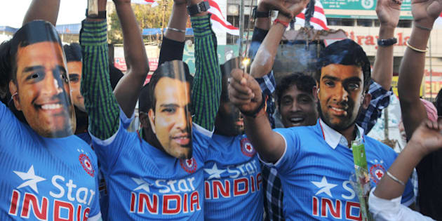 RANCHI, INDIA - MARCH 19: Cricket fans of the home town of team India Captain MS Dhoni celebrating the India team victory against Bangladesh in quarter final match of ongoing ICC Cricket World Cup 2015 tournament on March 19, 2015 in Ranchi, India. Dhoni guided his team into the semi-finals of this years World Cup with a 109-run romp over Bangladesh. With this win He became just the third captain, and the first Indian, to lead his country to 100 ODI wins, joining the Australian pair of Ricky Ponting and Allan Border. (Photo by Parwaz Khan/Hindustan Times via Getty Images)