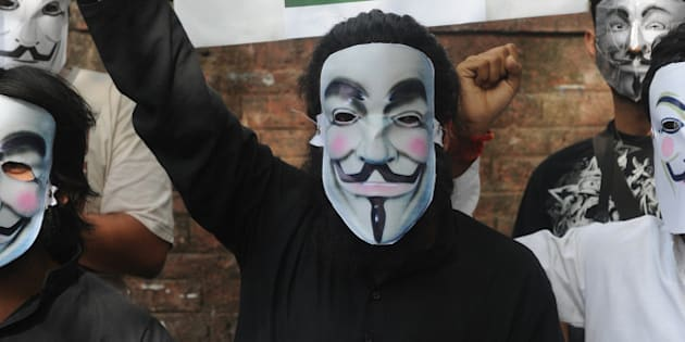 Activists supporting the group Anonymous wear masks as they protest against the Indian Government's increasingly restrictive regulation of the internet in New Delhi on June 9, 2012. Indian protesters responding to a call from global hacking movement Anonymous took to the streets on Saturday over what they considers growing government censorship of the Internet.The call for demonstrations follows a March 29 court order issued in the southern city of Chennai demanding 15 domestic Internet providers block access to file-sharing websites such as Pirate Bay. AFP PHOTO/ RAVEENDRAN        (Photo credit should read RAVEENDRAN/AFP/GettyImages)
