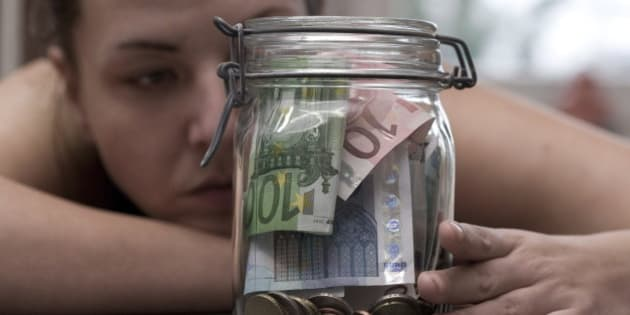 GERMANY, BONN - JANUARY 16:You can save on different art. Saved money in a preserving jar, on January 16, 2015 in Bonn, Germany. (Photo by Ulrich Baumgarten via Getty Images)