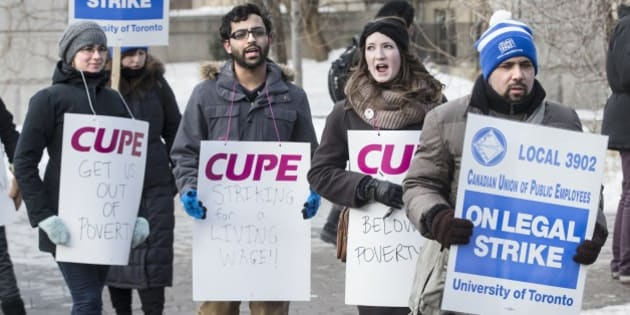 TORONTO, ON - MARCH 2:  Picketers from CUPE 3092, representing teaching assistants, began their strike in front of gate to campus on King's College Rd. and College Street.        (Bernard Weil/Toronto Star via Getty Images)