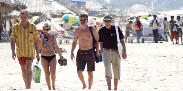 In this Dec. 16, 2008 photo, tourists walk on the beach in Goa, India. With the country on alert in the wake of the terror attacks in Mumbai that killed 164 people and nine accused gunmen, Goa officials have banned beach parties and stepped up patrols. Scores of spooked foreigners have canceled vacations. (AP Photo)