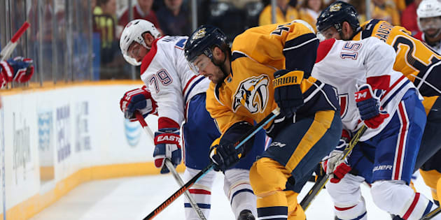 NASHVILLE, TN - MARCH 24: Taylor Beck #41 of the Nashville Predators battles for the puck against Andrei Markov #79 of the Montreal Canadiens during an NHL game at Bridgestone Arena on March 24, 2015 in Nashville, Tennessee. (Photo by John Russell/NHLI via Getty Images)