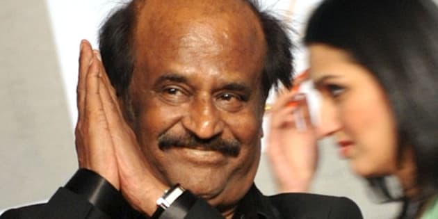 Indian actor Rajinikanth arrives to attend the 70th Birthday celebration of Bollywood Actor Amitabh Bachchan in Mumbai late October 10, 2012. AFP PHOTO/STR        (Photo credit should read STRDEL/AFP/GettyImages)