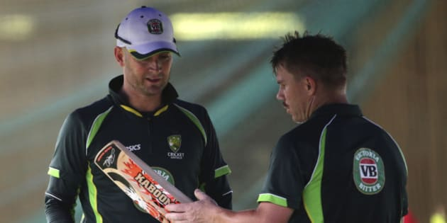 Australia's captain Michael Clarke, left, chats with David Warner after batting practice for the Cricket World Cup in Sydney, Australia, Wednesday, March 25, 2015. Australia will play India in a World Cup semifinal on Thursday to gain a place in the final against New Zealand.(AP Photo/Rob Griffith)