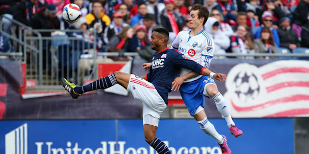 FOXBORO, MA - MARCH 21:  Darrius Barnes #25 of New England Revolution wins a loose ball ahead of Cameron Porter #39 of Montreal Impact during the first half at Gillette Stadium on March 21, 2015 in Foxboro, Massachusetts.  (Photo by Maddie Meyer/Getty Images)