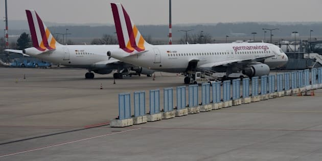 Two planes of German airline German Wings park at the airfield on Cologne/Bonn airport on March 24, 2015 in Cologne, western Germany . The head of low-budget airline Germanwings said there were 144 passengers and six crew on the Airbus A320 that crashed in the French Alps en route to Duesseldorf from Barcelona. AFP PHOTO / PATRIK STOLLARZ        (Photo credit should read PATRIK STOLLARZ/AFP/Getty Images)
