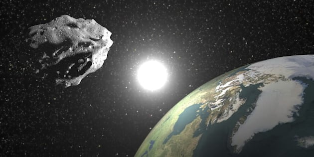 One asteroid into universe near earth planet, sun in the background - Elements of this image furnished by NASA