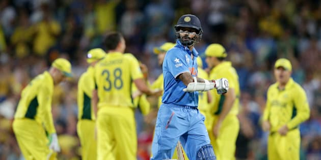 India's Shikhar Dhawan walks from the field after he was dismissed for 45 runs while batting against Australia during their Cricket World Cup semifinal in Sydney, Australia, Thursday, March 26, 2015. (AP Photo/Rob Griffith)