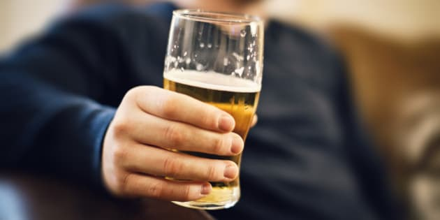Man drinking pint of beer.