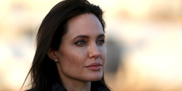 DOHUK, IRAQ - JANUARY 25: United Nations High Commissioner for Refugees (UNHCR) Special Envoy and famous actress Angelina Jolie (C) gives a speech during a press release after his visit at Hanke Refugee camp, built by UN for the Ezidi Refugees, fled from attacks of the Islamic State of Iraq and the Levant (ISIL), in 10 km west of Dohuk, Iraq on January 25, 2015. (Photo by Emrah Yorulmaz/Anadolu Agency/Getty Images)