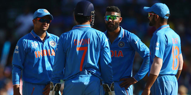 SYDNEY, AUSTRALIA - MARCH 26:  Suresh Raina, MS Dhoni, Ravindra Jadeja and Virat Kohli of India discuss whether to call for the DRS referral after an LBW shout against Aaron Finch of Australia was given not out during the 2015 Cricket World Cup Semi Final match between Australia and India at Sydney Cricket Ground on March 26, 2015 in Sydney, Australia.  (Photo by Mark Kolbe/Getty Images)