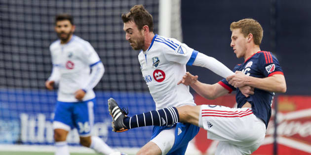 FOXBOUROUGH, MA - MARCH 20: New England Revolution Scott Caldwell (right) pressures Montreal Impact Eric Alexander during first half action of the MLS Opening Day at Gillette Stadium on Saturday, March 20, 2015. (Photo by Matthew J. Lee/The Boston Globe via Getty Images)