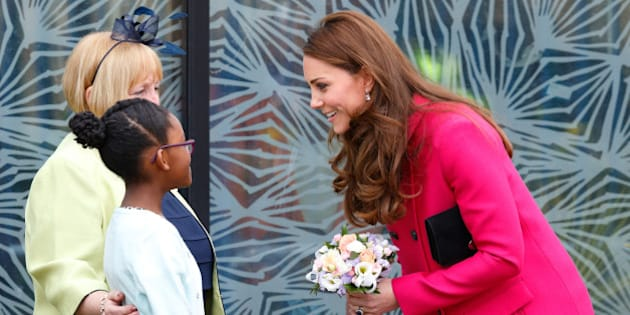 LONDON, UNITED KINGDOM - MARCH 27: (EMBARGOED FOR PUBLICATION IN UK NEWSPAPERS UNTIL 48 HOURS AFTER CREATE DATE AND TIME) Catherine, Duchess of Cambridge receives a posy of flowers from Stephen Lawrence's niece Mia as she visits the Stephen Lawrence Centre, Deptford during a day of engagements to support development opportunities for young people on March 27, 2015 in London, England. (Photo by Max Mumby/Indigo/Getty Images)