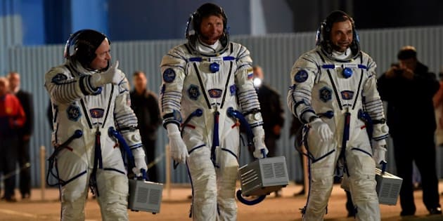From L: US astronaut Scott Kelly and Russian cosmonauts Gennady Padalka and Mikhail Kornienko walk after their space suits were tested at the Russian-leased Baikonur cosmodrome late on March 27, 2015. The international crew is scheduled to blast off to the ISS from Baikonur early on March 28, Kazakh time. AFP PHOTO / KIRILL KUDRYAVTSEV        (Photo credit should read KIRILL KUDRYAVTSEV/AFP/Getty Images)
