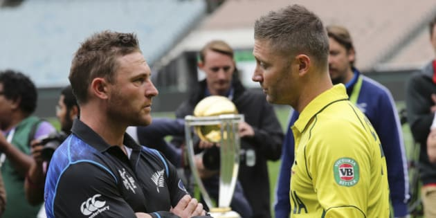 Australia's captain Michael Clarke right, and New Zealand's captain Brendon McCullum chat during a photo call with the Cricket World Cup trophy at the MCG in Melbourne, Australia, Saturday, March 28, 2015. New Zealand will tackle Australia  in the Cricket World Cup final Sunday.(AP Photo/Rob Griffith)