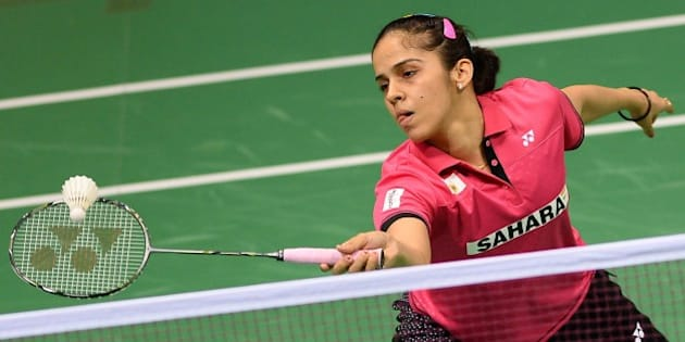 In this photograph taken on March 25, 2015, Saina Nehwal of India plays a shot during her women's badminton singles match against Riay Mukherjee of India at the Yonex-Sunrise India Open 2015 at the Siri Fort Sports Complex in New Delhi. Badminton star Saina Nehwal has shrugged off mounting pressure over whether she will become the first Indian woman ever to clinch the world number one ranking, at the Indian Open in New Delhi. Nehwal, currently number two after reaching the prestigious All-England Championship final this month, is expected to snatch the number one spot if she wins the tournament in front of a home crowd.  AFP PHOTO / SAJJAD HUSSAIN        (Photo credit should read SAJJAD HUSSAIN/AFP/Getty Images)