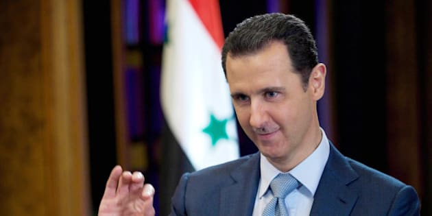 """FILE - In this Tuesday, Feb. 10, 2015 file photo released by the Syrian official news agency SANA, Syrian President Bashar Assad gestures during an interview with the BBC, in Damascus, Syria. Assad says he would be """"open"""" to a dialogue with the United States, but that it must be """"based on mutual respect."""" He made the remarks in an interview with Charlie Rose for CBS News' 60 Minutes. A short excerpt of the interview was posted online late Thursday, March 26, 2015.(AP Photo/SANA, File)"""