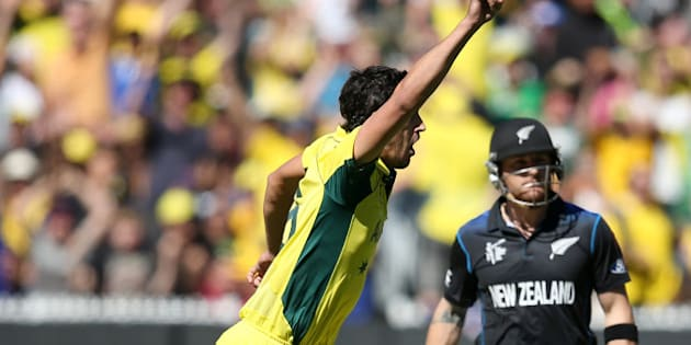 Australia's Mitchell Starc, left, celebrates after taking the wicket of New Zealand captain Brendon McCullum for no score during the Cricket World Cup final in Melbourne, Australia, Sunday, March 29, 2015. (AP Photo/Rick Rycroft)