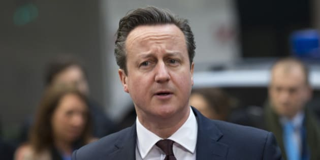 British Prime Minister David Cameron arrives for an EU summit in Brussels on Friday, March 20, 2015. EU leaders on Friday are looking to back U.N.-brokered efforts to form a national unity government in conflict-torn Libya that may include a possible mission to help provide security. (AP Photo/Francoise Mori)