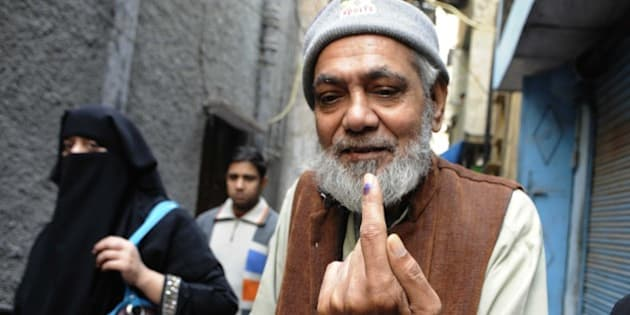 NEW DELHI, INDIA - FEBRUARY 7: An Indian Muslim man showing inked finger after casting vote at nearest polling booth during the Delhi Assembly Elections 2015, on February 7, 2015 in New Delhi, India. Delhi is headed for a record turnout on Saturday as more than 69.5% of the city's 1.33 crore voters cast their ballot till 5pm. After a slow start in the morning, polling picked up around noon, with scores of people queuing up at booths to exercise their franchise in an electrifying electoral battle that the national capital has never witnessed before. 69.5 per cent of 1.3 voters had been inked by 5 pm on Saturday, as Delhi looked set for a record turnout after a slow morning. There are 673 candidates in the fray now. Voting is taking place in 11,763 centers, located in schools. Many initial voters in middle class and posh areas were early morning walkers. (Photo by Subrata Biswas/Hindustan Times via Getty Images)