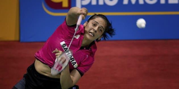 India's Saina Nehwal plays against  Thailand's Ratchanok Intanon at the women's singles final of Yonex Sunrise India Open Badminton in New Delhi, India, Sunday, March 29, 2015. (AP Photo/Saurabh Das)
