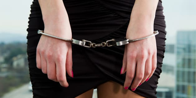Arrested young women in handcuffs