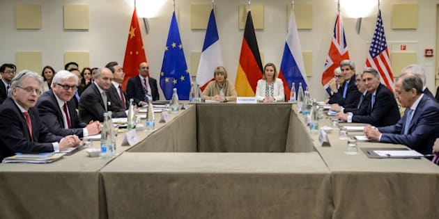 German Foreign Minister Frank-Walter Steinmeier (2L), French Foreign Minister Laurent Fabius (3L), Chinese Foreign Minister Wang Yi (4L), EU's deputy Foreign policy chief Helga Schmid (C,L), EU's Foreign policy chief Federica Mogherini (C,R) US Under Secretary for Political Affairs Wendy Sherman (5R), US Secretary of State John Kerry (4R), US Secretary of Energy Ernest Moniz (3R), British Foreign Secretary Philip Hammond (2R) and Russian Foreign Minister Sergei Lavrov (R) wait for a P5+1 meeting at the Beau Rivage Palace Hotel March 29, 2015 in Lausanne. AFP PHOTO / FABRICE COFFRINI        (Photo credit should read FABRICE COFFRINI/AFP/Getty Images)