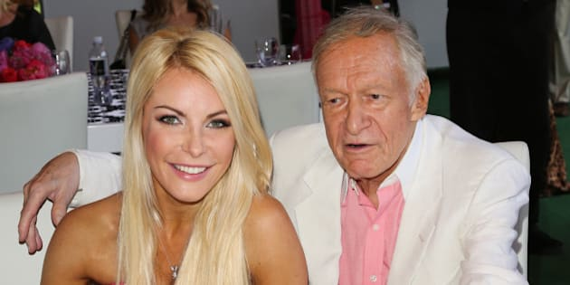 BEVERLY HILLS, CA - MAY 09:  Playboy Founder Hugh Hefner (R) and his wife Playboy Playmate Crystal Hefner (L) attend the 2013 Playmate Of The Year announcement at The Playboy Mansion on May 9, 2013 in Beverly Hills, California.  (Photo by Paul Archuleta/FilmMagic)