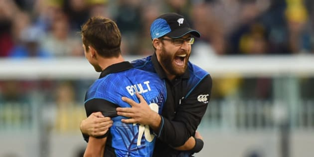 New Zealand's Ross Taylor hugs teammate Trent Boult for the dismissal of Australia's Aaron Finch during the ICC Cricket World Cup final in Melbourne, Australia, Sunday, March 29, 2015. (AP Photo/Andy Brownbill)