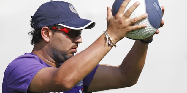 India's Yuvraj Singh holds a ball during a practice session in Ahmadabad, India, Tueday, Nov. 13, 2012. India and England are scheduled to play four cricket tests with the first test beginning on Nov. 15 in Ahmedabad. (AP Photo/Ajit Solanki)